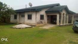 Two (2) plots of land and a standard three(3) bedroom flat for sale