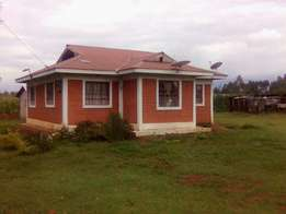 Land three acres with two bedroomed house at kuakali tumaini 8m