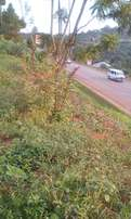 One acre with a land title along Entebbe highway.