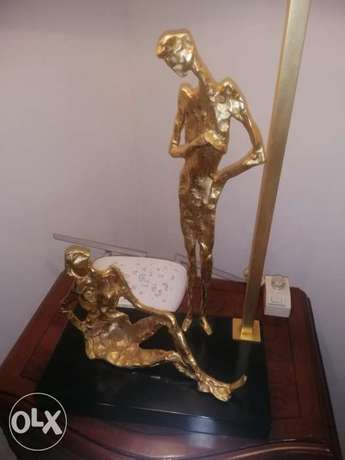 SCULPTURE TABLE LAMP with Led lamp and dimming device.