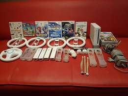Wii console,accessories and 9 games