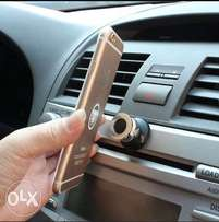 Magnetic dashboard phone holder