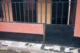 One room in a fenced compound for rent in Rukpokwu