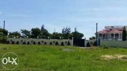 AMAZING 1/2 Acre Plot with a perimeter wall in Utange.