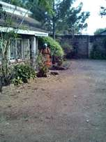 A two bedroom house to let on own compound