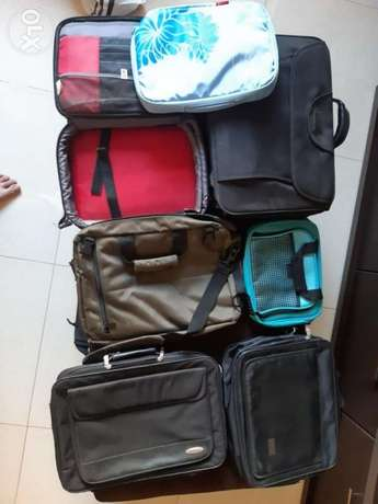 7 laptop bags many sizes ised but like new