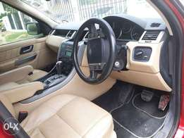 Red Clean Rangerover Sports light interior 2008 model. KCE