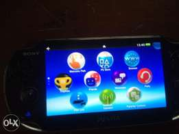 PS Vita PCH-1104 with FIfA 15 and Uncharted Golden Abyss With more gam
