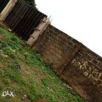 Uncompleted three bedroom on half plot of land for sale at Baruwa.