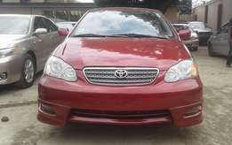 Extra clean foreign used Red Toyota Corolla Sport 2006 model
