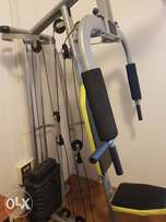 Multifuction gym available for quick sale. Complete with weights