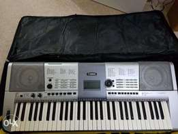UK used silver Yamaha e-series keyboard with picth bend wheel