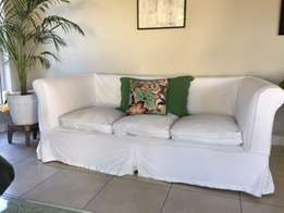 white sofa with loose covers