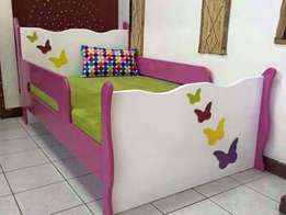 3 x 6 bright coloured bed at 380,000 with a new mattress