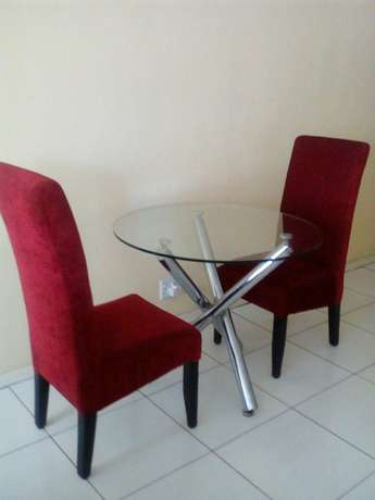 Two chairs with glass table for 2200 all of them Or Tambo Int Airport - image 1