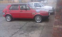 Vw golf 1.3 with red and black interior.15 inch angle mags and music.