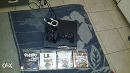 Ps3 console 2 remotes 4 games