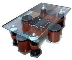 Four Puffs Clear Glass Top coffee table with a clock