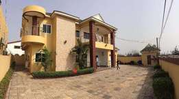 4 bedrooms self compound with 1 bedroom boys quarters at eastLegon