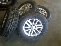 "Set of silver 17"" mags with new tyres brigestone dueller all terrain"