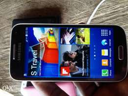 Samsung S4 mini. Cracked, but doesn't affect it.
