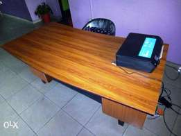 Clean 6 feet by 3 feet curvy shaped Office Table with 6 drawers