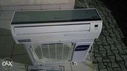 Brand New Polystar 1.5 HP Split unit AC used by a white man at banana