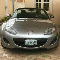 A sweet mini super car...Mazda MX5, bought brand new, with low miles