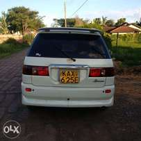 7 seater, clean interior, alloy rims music system.