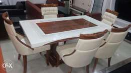 This is a brand new imported marble dining table set