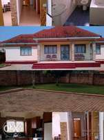 Fully furnished 4 bedroom,2 baths house in Arkright Bwebajja.