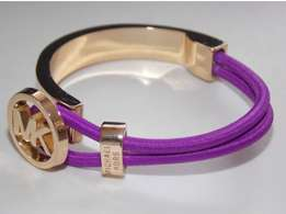 Michael Kors golden bracelet with purple band