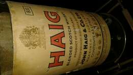 Collectors Haig 4.5 ltr Whiskey bottle. On brass stand. Mint.