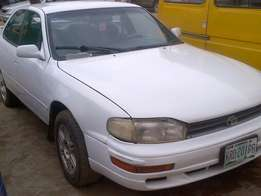 White clean Toyota Camry with 4plugs