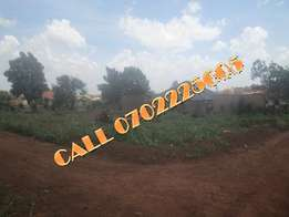 Perfectly priced 100 by 100 ft plot for sale in Kiira-Bulindo at 120m