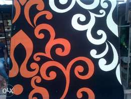 black background with orange and cream 5 by 7 available for pick up