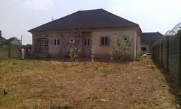 FOR SALE 4 bedroom bungalow with a space to build Boy's quarters..