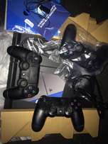 PlayStation 4S + accessories + 5games