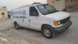 Toks 06 Ford E150 cargo bus