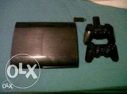 Playstation 3 + 2 Controllers + 10 Games