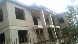 Unfinished apartment building for sale at 800m Nsambya behind Embassy