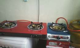Brand new two burner cookers fitted with full 13 kg gas cylinders