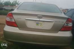 Toyota camry 2003 model,Golden brown XLE full option,Lagos clearing