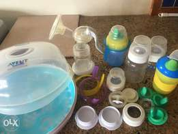 Manual avent breast pump and microwave sterilizer