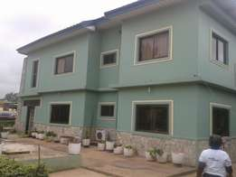 11 bedroom storey house of 3 apartments on 1 acre at Dansoman