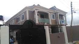Lovely newly built 2 bedroom flat all tiles floor pop at command ipaja