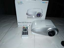 Projector led brand new lightweight and portable fits in your palm