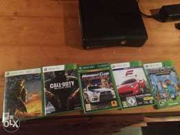 Xbox 360 (mint condition) + games