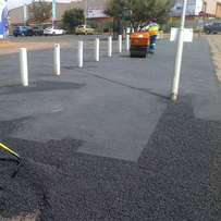 Tar surfacing,paving,concrete slabs,graveling and road markings