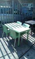 green plastic table with 4 green chairs
